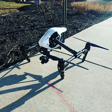 A thermal camera mounted on a black and white drone.